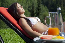 woman relaxing in the sun at hotel forsthaus auerhahn